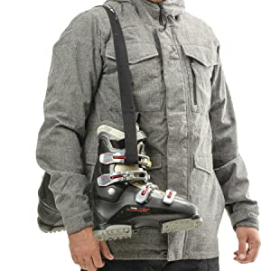 Athletico Ski Boot Carrier Strap holding boots over shoulder
