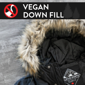 "Close-up of Alpine North jacket with an anti-sign of a goose. Title says ""vegan down fill."""