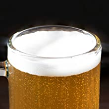 smooth cylindrical beer glass mug with beer and foam