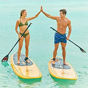 Fit couple on paddle boards