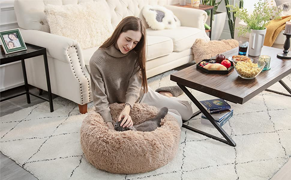 application scenario of the Bedsure Calming Bed for Dogs - Washable Round Dog Bed --Slip Faux Fur Donut Cuddler Cat Bed