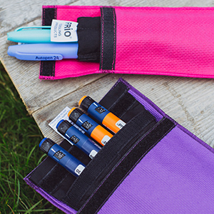 Two FRIO wallets outdoors displaying medication