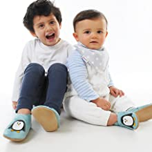 Baby and toddler brothers wearing Percy Penguin Crib Shoes by Dotty Fish, soft sole baby shoes