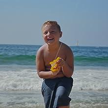 Boy holding X Kite on Beach