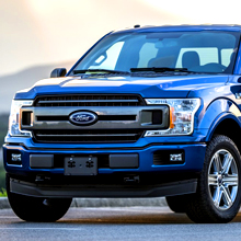 blue-ford-f150-pickup-truck-with-no-decals-in-a-parking-lot-on-a-sunny-day