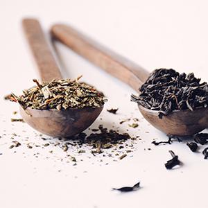 Loose leaf tea on a wooden spoon