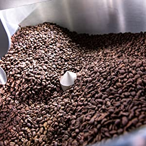 [Image of coffee beans being roasted]