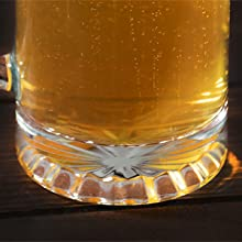 beer glass bottom with starburst pattern cutout for visual effect on table with beer