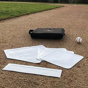 bag of baseball bases on field