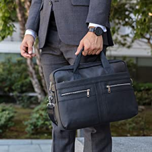 Banker carrying black briefcase with padded handle for comfortable easy transport of necessities