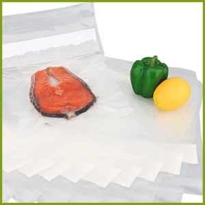 fish sealed in vacuum seal pouch with pepper and lemon