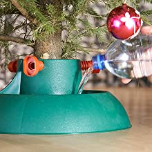 Christmas tree saver food tree stand prevent reduce needle drop how to make a tree last longer
