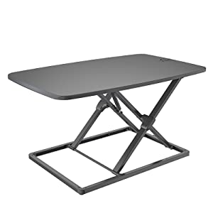 The sit to stand riser converter desk.