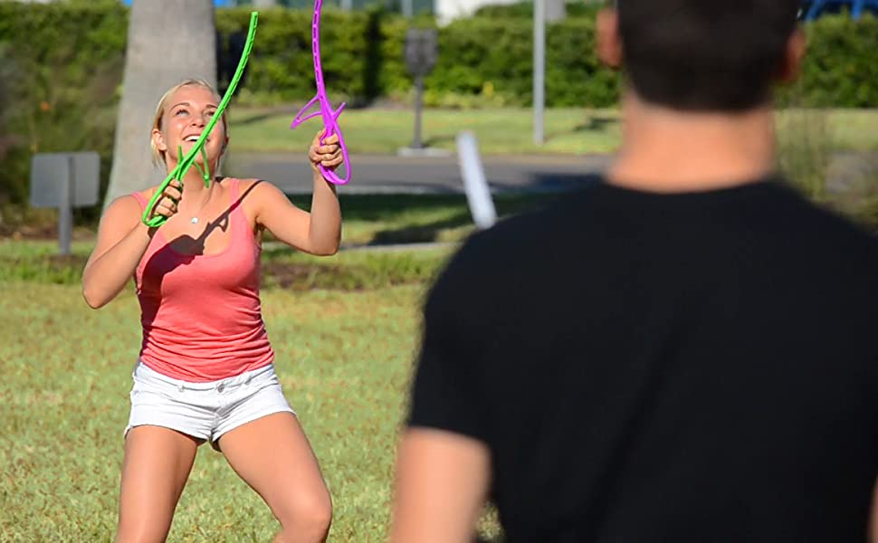 Girl playing RingStix having fun with friend at the park