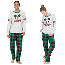 Man and woman in matching green and red mickey pajamas on white background