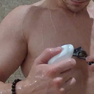 man shaving chest with remay