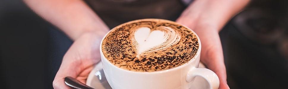 Barista holding a Teifi coffee cappuccino