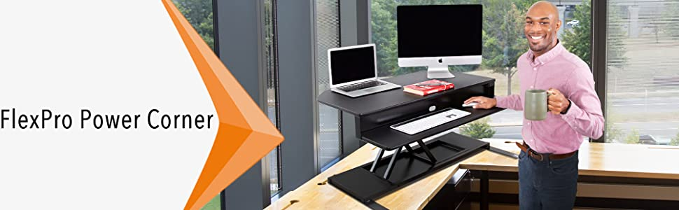 Stand Steady FlexPro Power 40 Inch Electric Corner Standing Desk Converter in an office.