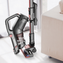 Roomie Tec Cordless Stick Vacuum Handheld in self standing upright position with wall mount