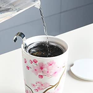 Pour hot  water over the tea cup
