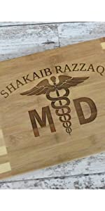 Custom engraved profession theme bamboo cutting board with MD and medical logo for graduation gift