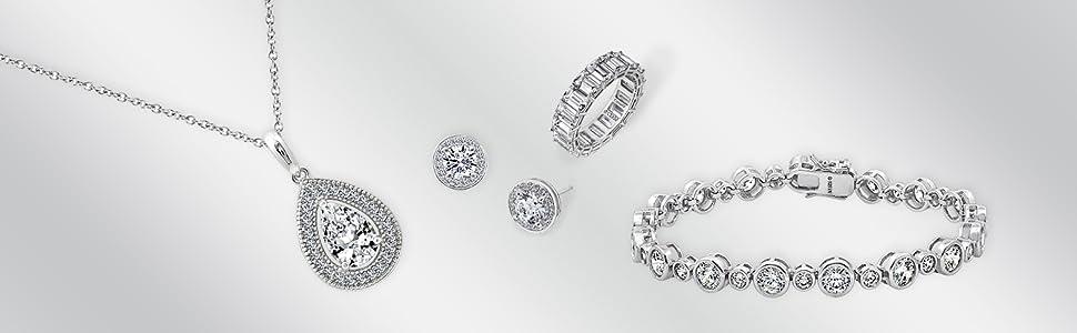 fine jewelry, silver jewelry, tennis bracelet, halo earrings, eternity ring, emerald cut ring