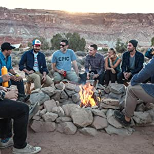 SWOOC team sitting around a campfire