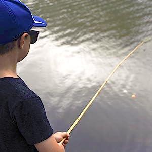 Child fishing with bamboo fishing pole