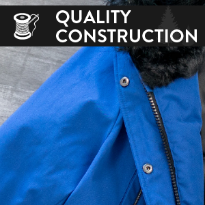 "A blue coat with an illustration of a needle and thread in front of it. Says ""quality construction."""
