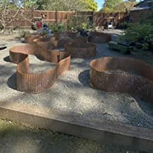 "12"" tall Rusted metal landscape edging for rock beds"