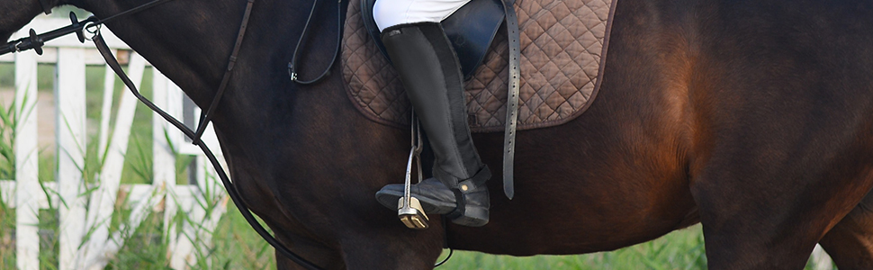 A cropped image of a rider wearing the chaps while on a horse