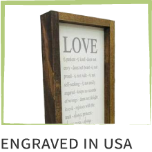 """Photo of a sign in a wooden frame. Text below reads, """"Engraved in USA."""""""