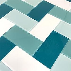 herringbone pattern of glass subway tile