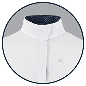 Collar with hidden buttons and contrasting inner lining.