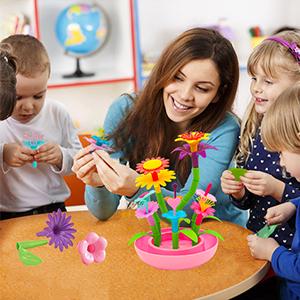 girls building toys