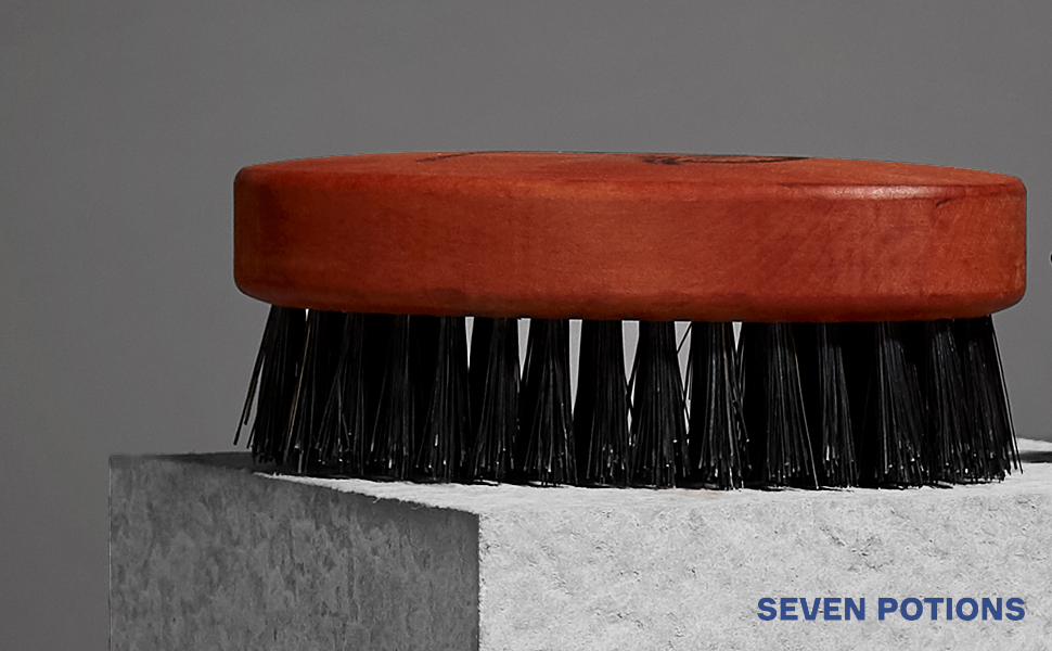Seven Potions Gentlemen's grooming essentials beard boar bristle brush on table with coffee beans