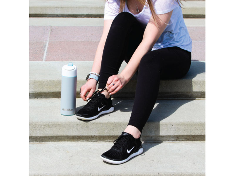 Jogger with an astrea ONE water bottle