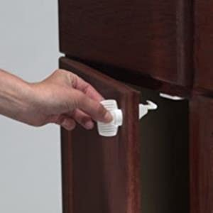 Kidco Magnet lock child safety cabinet or drawer disengage feature