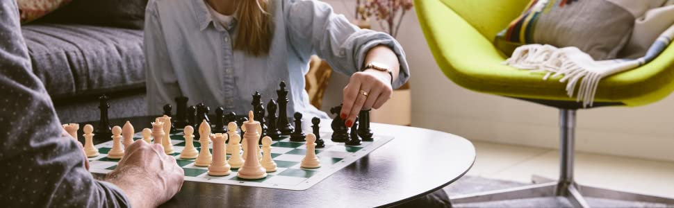 Players moving chess pieces