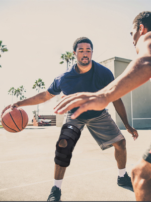 Sporting hinged knee support for basketball