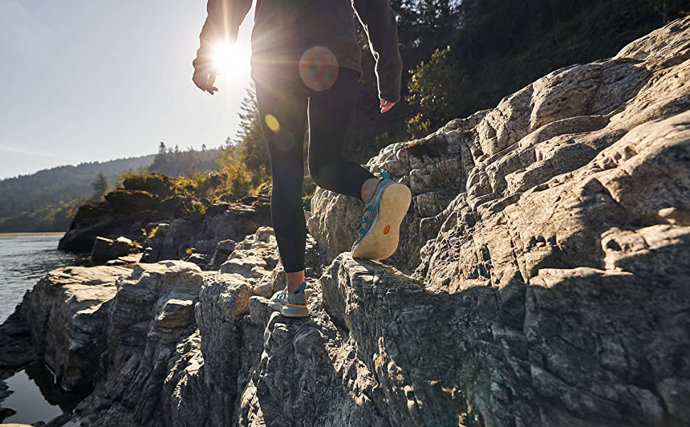 woman walking on the cliff