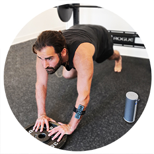 Crossfit Gym Athlete wearing Chubby Buttons 2: The wearable/stickable bluetooth remote action sports
