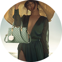 Green top handle bag with pompom