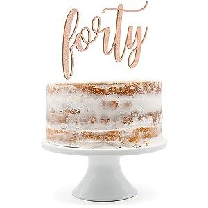 rose gold forty cake topper shown on naked cake