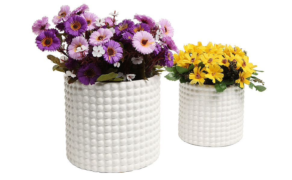 hobnail design pots with decorative flowers displayed