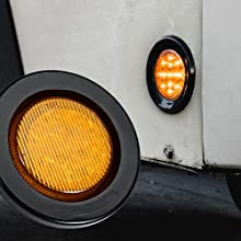 """4pc Amber 2.5"""" 13-LED Clearance Side Marker close up on trailer."""