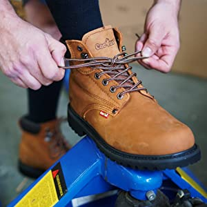 6 inch Brown leather lace-up construction work boot with rubber soles. ideal for construction work.
