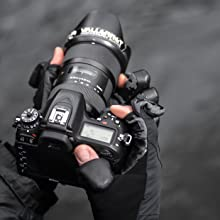 Photography gloves holding camera