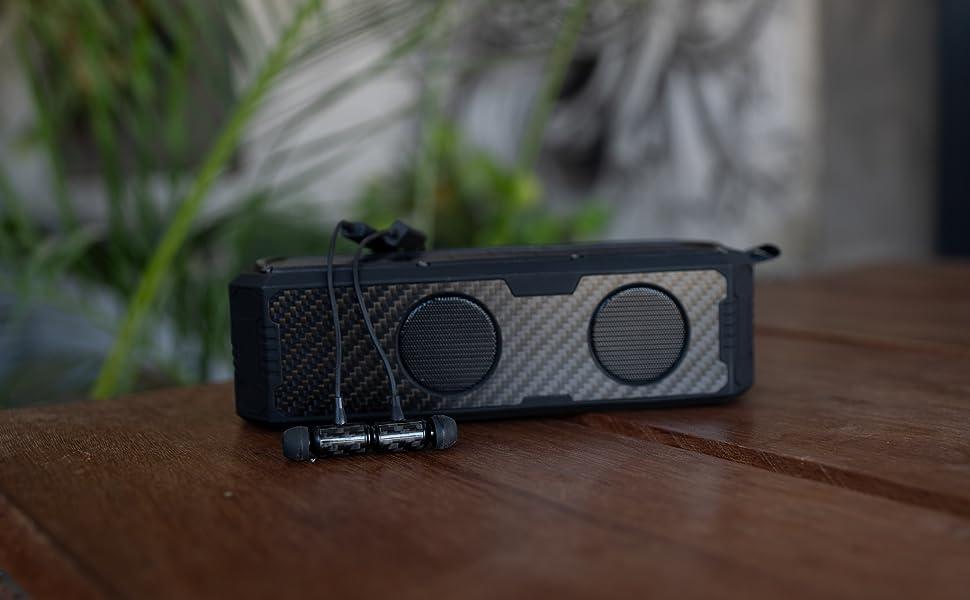 Carbon fiber bluetooth solar powered speaker earbuds headphones audio earphones