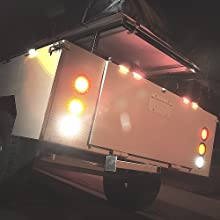 """4pc White 4"""" 10-LED Round Tail Light on trailer showing it on."""
